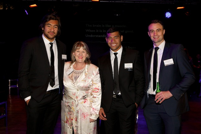 Vicki Lee and Tim Edmonds of Cure Kids NZ, with All Blacks Steven Luatua (L) and Charles Piutau (R)